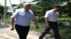 Marian Lupu, președintele PDM, în vizită la dna Marchitan, locuitoarea satului Corjeuți, care a avut de suferit pe urma inundațiilor